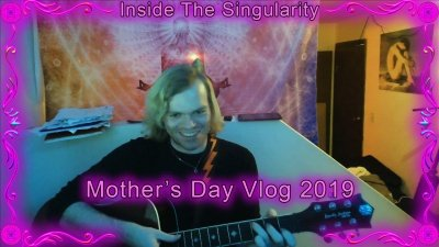 "Luke playing guitar with the words ""Mother's Day Vlog 2019"" over the image."